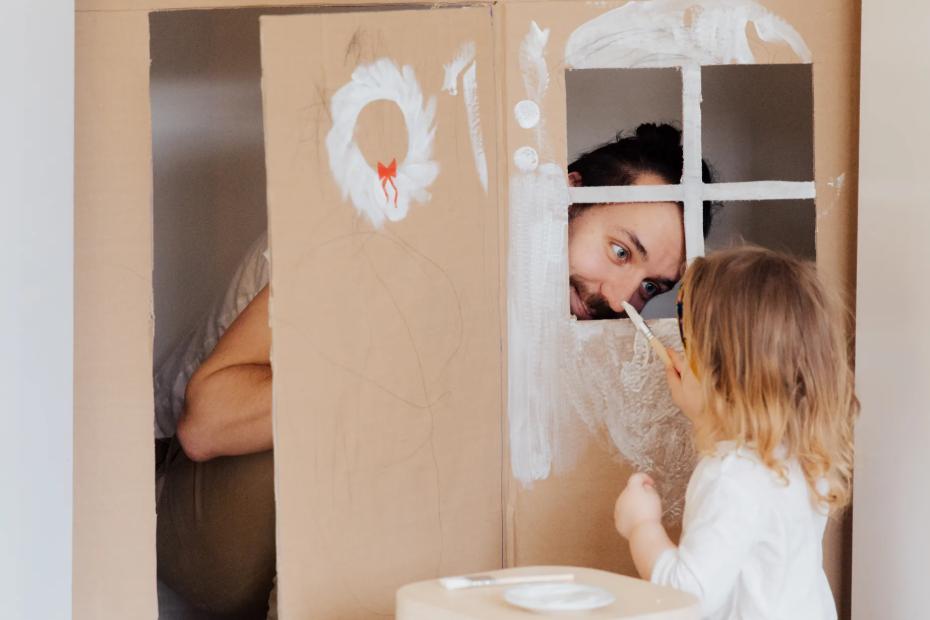 little girl paitning DIY house